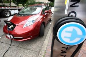 A Nissan Leaf charges at a electric vehicle charging station Thursday, Aug. 18, 2011, in Portland, Ore.
