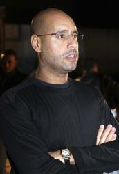 Saif al-Islam Gadhafi waits before a press conference in Tripoli last year.