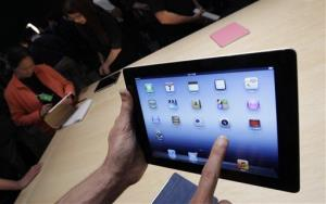 In this March 7, 2012, file photo, a new Apple iPad is on display in San Francisco.