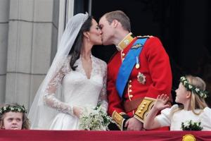 This Friday, April 29, 2011 file photo shows Prince William and his wife Kate Middleton kissing on the balcony of Buckingham Palace, London, following their wedding at Westminster Abbey.