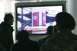 South Koreans watch a TV news program which shows North Korea's Unha-3 rocket at Seoul train station in Seoul, South Korea, Monday, April 9, 2012.