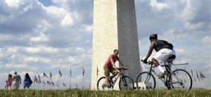In this March 15, 2012, file photo people enjoy the warm weather near the Washington National Monument in Washington.