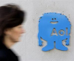 In this Feb. 7, 2011 photo, a small AOL placard is displayed at their offices in New York.