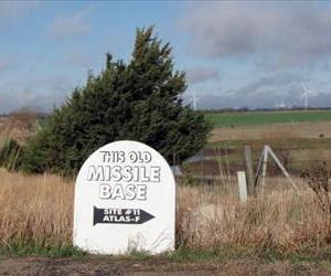 A sign on a rural road points the way to a site where survival condos are being built in a former nuclear missile silo north of Salina, Kansas.