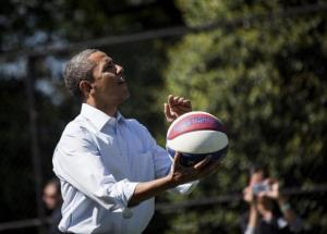 Barack Obama gets ready to shoot a basket during one of the activities during the annual Easter Egg Roll on the South Lawn of the White House yesterday.