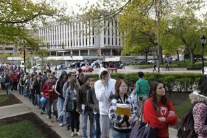 Students and faculty line up with visitors to get through a security checkpoint  to enter the Cathedral of Learning on the University of Pittsburgh campus, April 10, 2012.