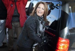 Michelle Bachmann pumps gas for customers at the Fast Break Gas Station in Lino Lakes, Minn. where she was hosting an energy news conference last week.
