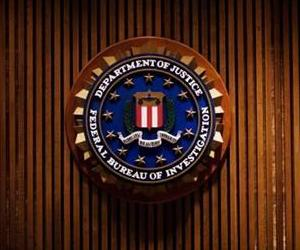 A crest of the Federal Bureau of Investigation is seen 03 August 2007 inside the J. Edgar Hoover FBI Building in Washington, DC.