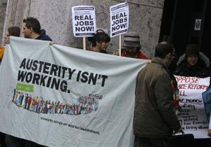Protesters demonstrate outside the Department of Work and Pensions in London.
