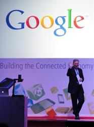 Google Chairman Eric Schmidt appears during a conference at the Mobile World Congress in Barcelona, Spain, Tuesday, Feb. 28, 2012.