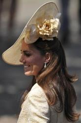 This Saturday, July 30, 2011 file photo shows Britain's Catherine, Duchess of Cambridge, as she arrives for the wedding of Zara Phillips and England rugby star Mike Tindall, in Edinburgh, Scotland.
