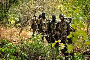 Ugandan soldiers patrol on April 18, 2012 through the Central African jungle during an operation to fish out Joseph Kony.