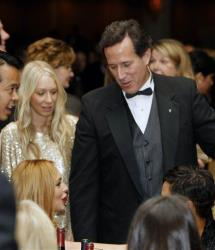 Rick Santorum talks with Lindsay Lohan at the the White House Correspondents' Association Dinner, Saturday, April 28, 2012 in Washington.