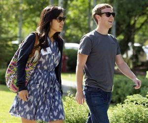 Mark Zuckerberg walks to morning sessions with his girlfriend Priscilla Chan during the 2011 Allen and Co. Sun Valley Conference, July 9, 2011.