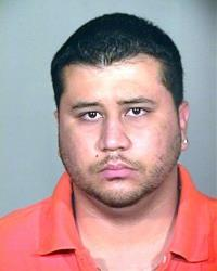 George Zimmerman is seen in police mug shot, in the orange polo reportedly seen in a MySpace photo.