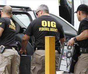 Office of Inspecter General federal agents load computers seized from Willsand Home Health Agency, Inc. into a van in Miami, May 2, 2012.