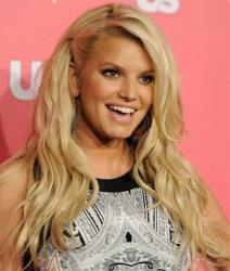 In a April 26, 2011 file photo, Jessica Simpson poses at Us Weekly's Annual Hot Hollywood Style Issue event, in Los Angeles.