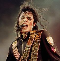 In this Aug. 29, 1993 file photo, pop singer Michael Jackson performs during his Dangerous concert in National Stadium, Singapore.
