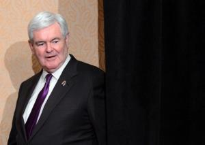 Newt Gingrich arrives to give a press briefing in Arlington, Virginia, on May 2, 2012.