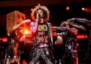 In this Dec. 9, 2011 file photo, singer RedFoo, center, and LMFAO perform at Z100's Jingle Ball concert at Madison Square Garden in New York.