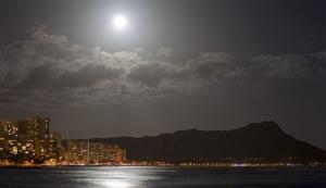 A supermoon lights up Waikiki and Diamond Head Saturday, May 5, 2012, in Honolulu.