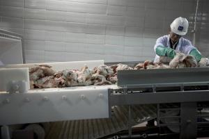 In this March 29, 2012, file photo. a worker sorts cuts of beef that are used in the manufacturing process of pink slime, at Beef Products Inc.'s plant in South Sioux City, Neb.