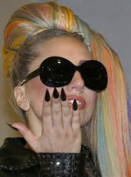 Lady Gaga blows a kiss to journalists upon her arrival at Narita international airport in Narita, east of Tokyo, Tuesday.