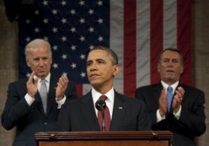 President Barack Obama, flanked by Vice President Joe Biden and House Speaker John Boehner, delivers his State of the Union before Congress, January 24, 2012.