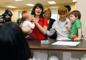 A couple holding two children are refused a marriage license at the Forsyth County Register of Deeds office in Winston-Salem.