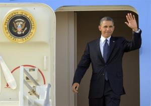 President Obama waves after arriving in Los Angeles last night.