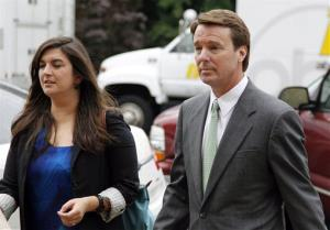 Cate Edwards walks with her father John Edwards into the federal courthouse in Greensboro, N.C., as the defense continues in John Edwards' campaign corruption trial Monday, May 14, 2012.