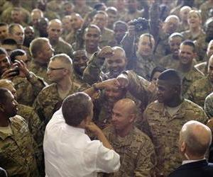 President Barack Obama fist bumps service members after he addressed troops at Bagram Air Field, Afghanistan, Wednesday, May 2, 2012.