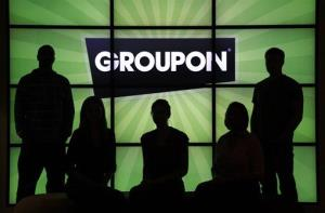Groupon employees in front the company logo in the lobby of the online coupon company's Chicago offices.