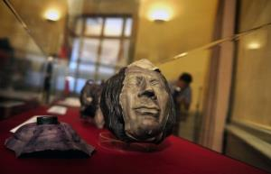 An Inca skull covered in clay on display in Lima, Peru.