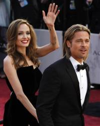 Actor Brad Pitt, right, and actress Angelina Jolie arrive before the 84th Academy Awards on Sunday, Feb. 26, 2012, in the Hollywood section of Los Angeles.