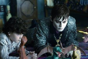 In this film image released by Warner Bros., Gully McGrath portrays David Collins, left, and Johnny Depp portrays Barnabas Collins in a scene from Dark Shadows.