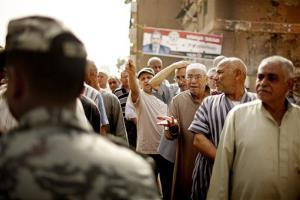 Egyptian voters argue with a solider as they wait cast ballots in Basateen a southern suburb of Cario, Egypt on Wednesday, May 23, 2012.