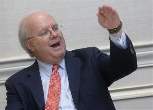 Karl Rove speaks to members of the media before a Walton County Chamber of Commerce dinner at the Baytowne Conference Center, Thursday, Dec. 1, 2011 in Sandestin, Fla.