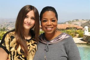 This undated image released by Harpo, Inc. shows host Oprah Winfrey posing with Paris Jackson, daughter of the late pop icon Michael Jackson in Los Angeles.