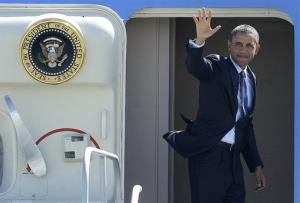 President Barack Obama waves as he departs San Francisco International Airport on Air Force One in San Francisco, Wednesday, June 6, 2012.