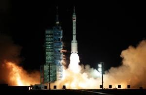 In this photo released by China's Xinhua News Agency, the Shenzhou-8 blasts off from the launch pad at the Jiuquan Satellite Launch Center in northwest China on Nov. 1, 2011.