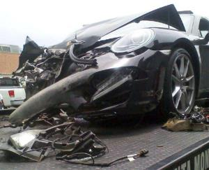 Lindsay Lohan's crashed Porsche lies on a flatbed tow truck, after it collided with a truck on Pacific Coast Highway in Santa Monica, Calif., Friday, June 8, 2012.