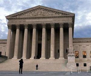 In this March 25, 2012, file photo, people visit the Supreme Court in Washington.