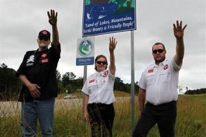 Members of the International Keystone Knights Realm of Georgia perform a traditional Klan salute along the portion of highway they wanted to adopt.