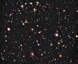 The oldest galaxy in this Hubble photo is a 600-million-year-old whippersnapper.