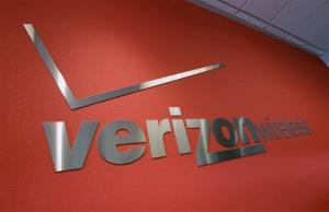 This Tuesday, June 12, 2012, photo shows a Verizon sign at a Verizon store in Mountain View, Calif.