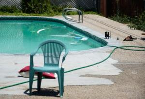 Sandals are seen next to a pool where Rodney King was found dead in the bottom of the pool on June 17, 2012 in Rialto, California.