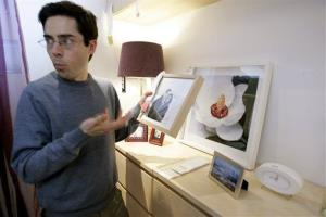 Mark Malkoff, a comedian and filmmaker, reacts to a display photo of models in his bedroom in a showroom at the Ikea store in Paramus, NJ, Monday, Jan. 7, 2008.