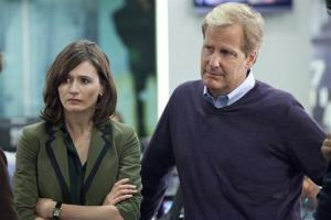 This publicity image released by HBO shows Emily Mortimer as Mackenzie MacHale , left, and Jeff Daniels as Will McAvoy on the HBO series 'The Newsroom.'