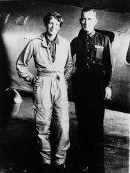 In a 1937 file photo aviator Amelia Earhart and her navigator, Fred Noonan, pose in front of their twin-engine Lockheed Electra in Los Angeles.